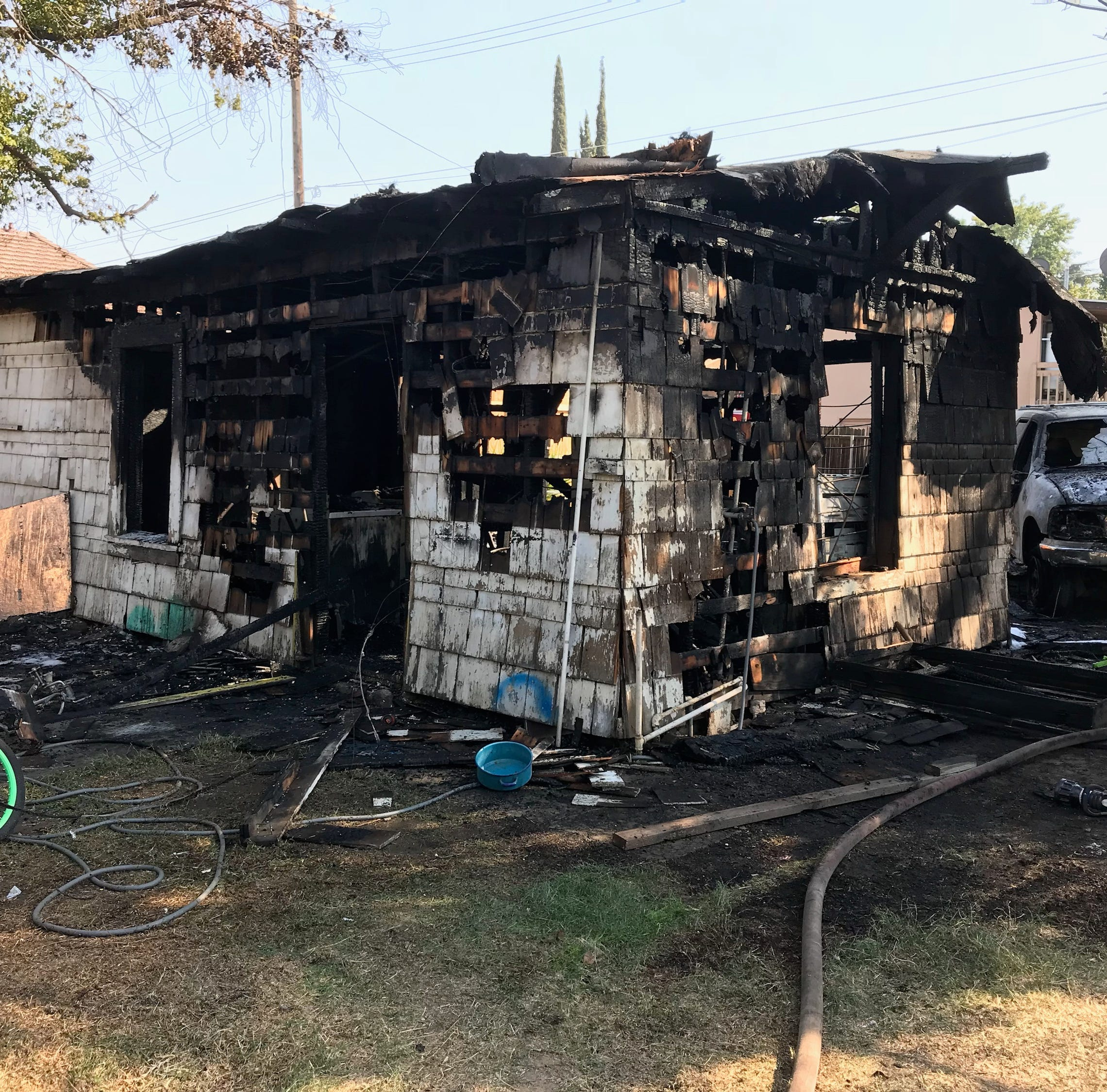 Neighbors suspect squatters are the cause of an east Tulare house fire