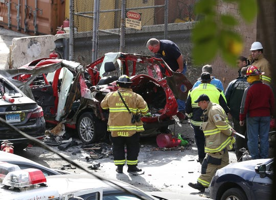 Fire and MetroNorth officials look over the car that was damage in an explosion in the MetroNorth North White Plains yard Oct. 19, 2018.