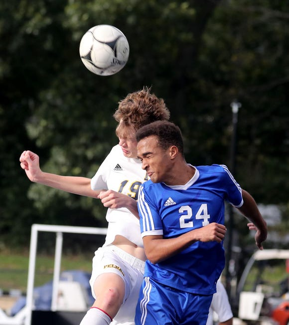 Pelham's Samuel Cork and Pearl River's Jason Waitman vie for the ball during a first round soccer playoff game at Pearl River High School Oct. 19, 2018. Pearl River defeated Pelham 3-1.