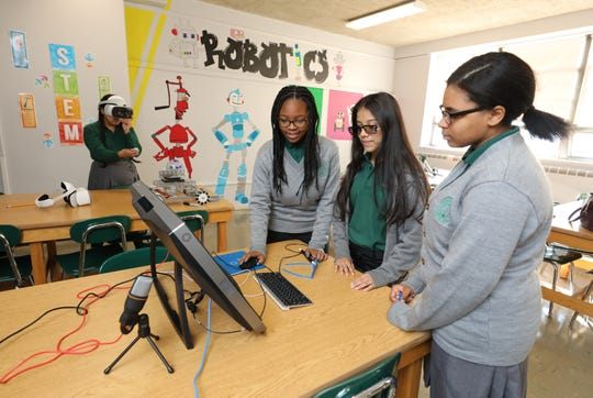 Saint Barnabas High School students from left, Maria Romero, Rachel Stephenson, Kathleen Grand and Wynsdai Rogers, work with new virtual reality equipment, Oct. 19, 2018, obtained through an A Community Thrives grant, from the Gannett, Co.