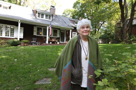 Barbara MacDonald, historian for the Scarsdale Historical Society, stands in front of 1020 Post Road in Scarsdale.  The center part of the home dates back to 1687.  The house, currently owned by Charles and Janice Feldman, is up for sale for $1.395 million. Macdonald also lived there for three decades until 1998, raising her four children.