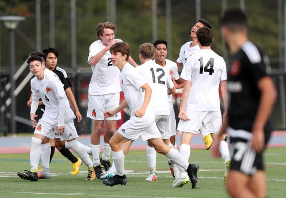 Mamaroneck players celebrate Matt Giraldo's first half goal against  White Plains during boys soccer playoff action at White Plains High School Oct. 19, 2018. Mamaroneck won the game 3-0.