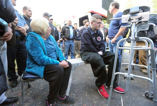 Willy McCue, 20, right, and his grandmother Martha Beiber, left, take a seat on the driveway of their New City home on Friday, October 19, 2018.