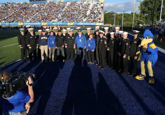 USS Delaware crew members join Delaware and University of Delaware officials for recognition at Delaware Stadium Saturday.