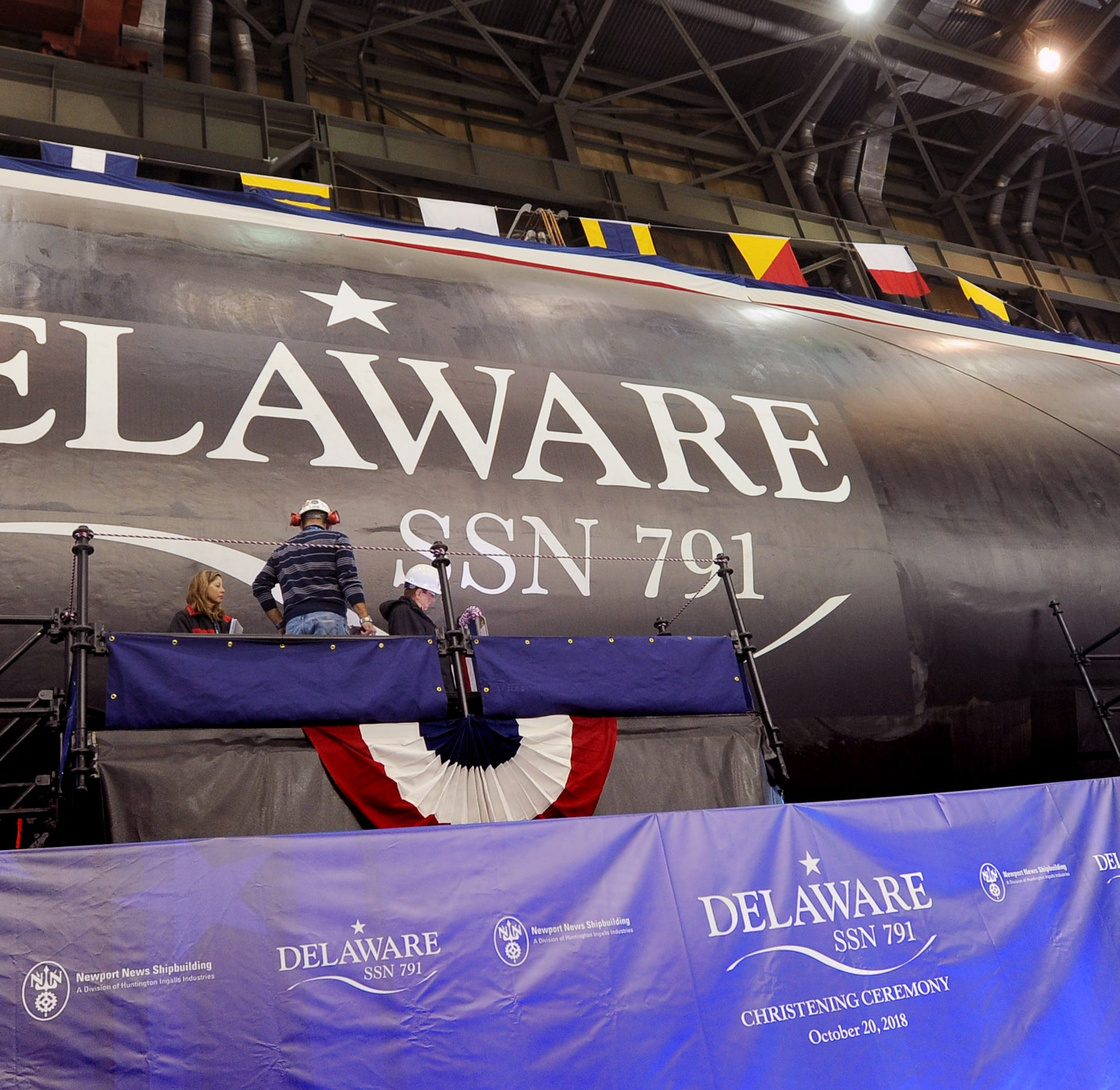 Newport News Shipbuilding crews prepare for the christening of the Virginia-class atomic submarine USS Delaware (SSN-791). It will be about a year before the submarine is fully commissioned.