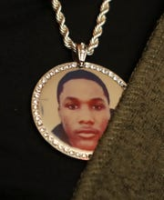 Grayson Ewell's image looks out from a pendant worn by his mother, Felicia McKinnon, after he was shot and killed in early October 2018.
