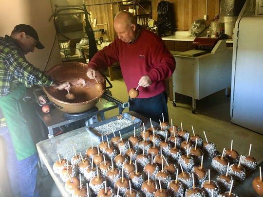 Richard and Nick Govatos make a batch of caramel cover apples at Govatos Chocolate on N. Market St.