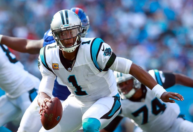 Panthers quarterback Cam Newton tries to escape pressure against the Giants on Oct. 7. Newton has 208 yards rushing this season, tops among quarterbacks.