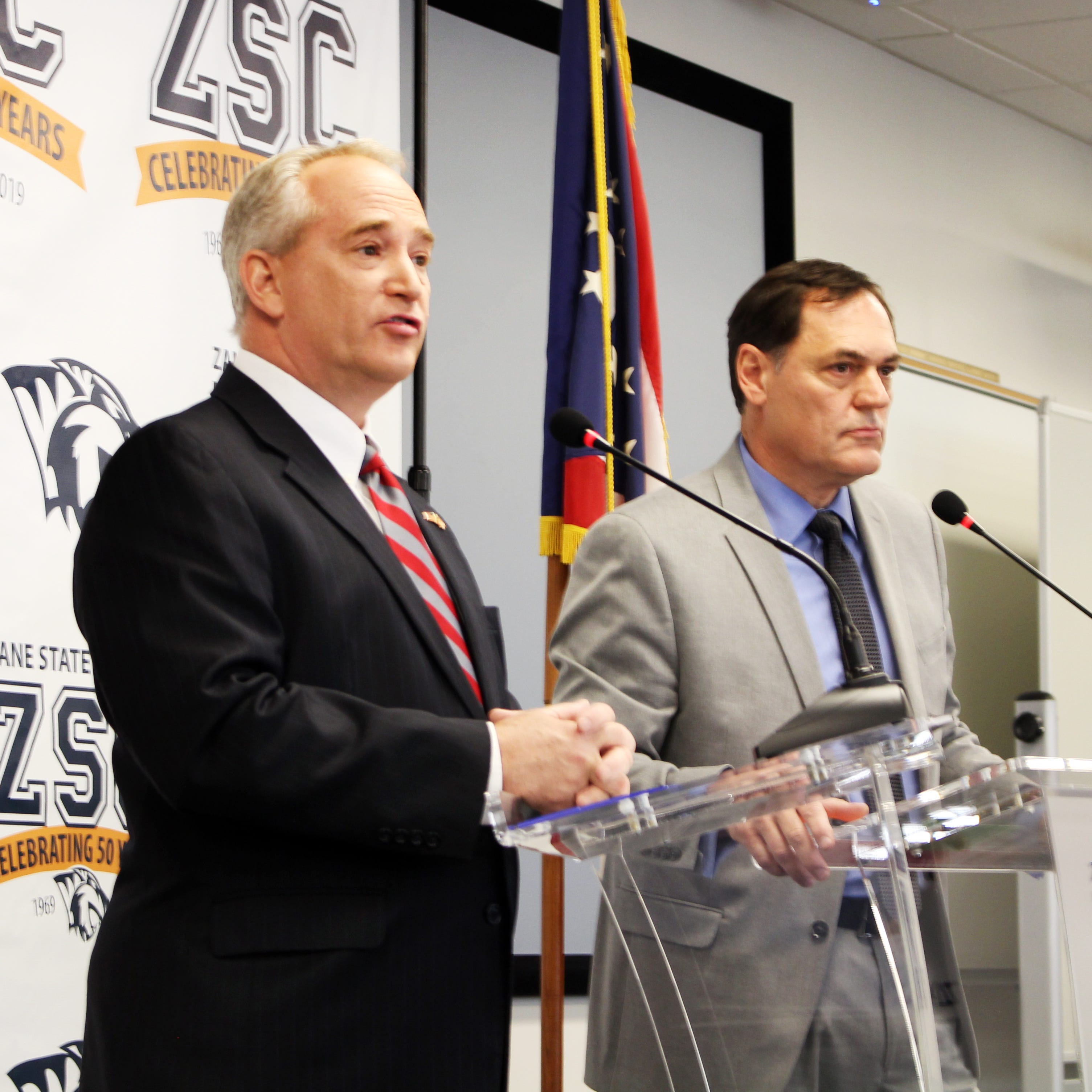 State auditor candidates Keith Faver, left, and Zack Space debate at Zane State College on Friday.