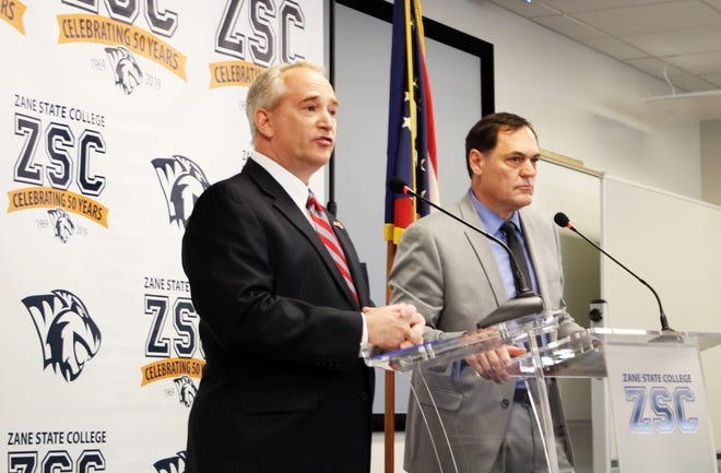 State auditor candidates Keith Faber, left, and Zack Space debate at Zane State College on Friday.