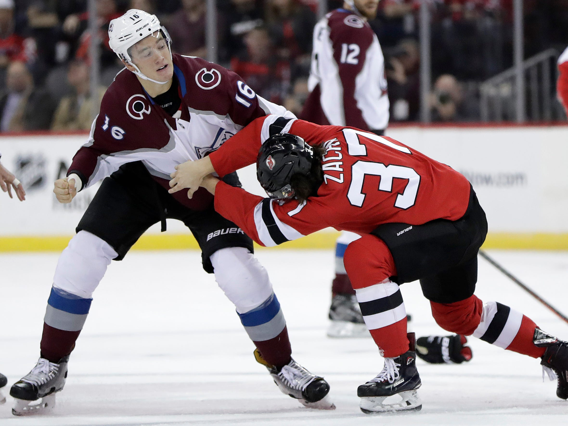 Oct. 18: Avalanche defenseman Nikita Zadorov, left, vs. Devils center Pavel Zacha