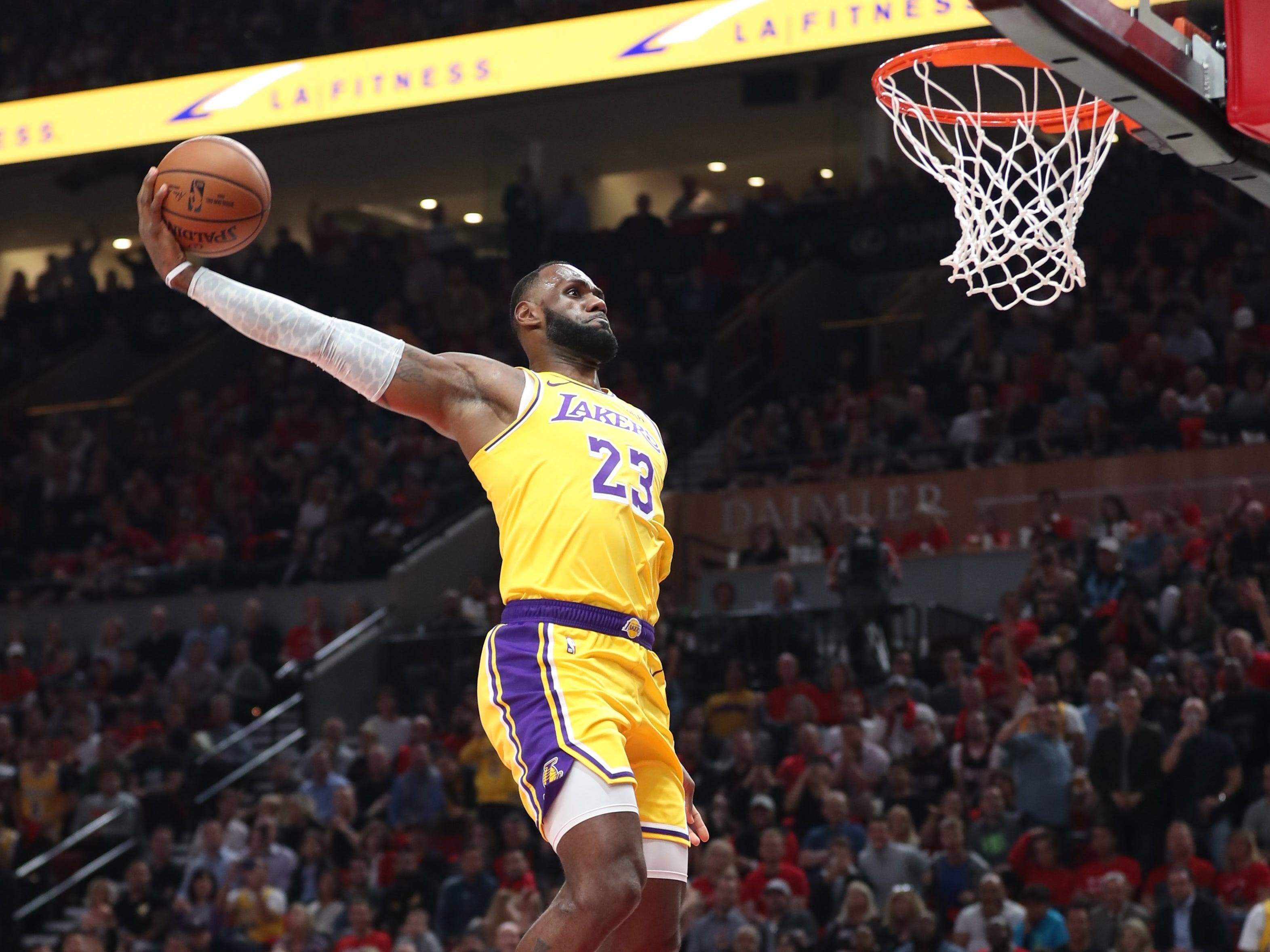 Oct. 18, 2018: James soars to the hoop to slam home his first bucket as a member of the Lakers against the Blazers in Portland.