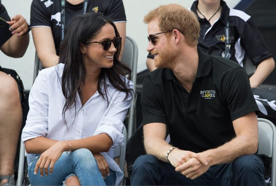 Prince Harry and Meghan Markle watch wheelchair tennis at the Invictus Games Toronto 2017 on Sept. 25, 2017, in their first public appearance as a couple.