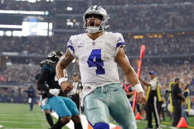 Dak Prescott celebrates after scoring a touchdown against the Jaguars.