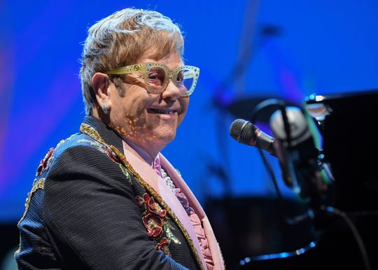 """Singer/songwriter Elton John performs onstage during his """"Farewell Yellow Brick Road"""" final tour at Madison Square Garden on Thursday, Oct. 18, 2018, in New York. (Photo by Evan Agostini/Invision/AP) ORG XMIT: NYEA106"""