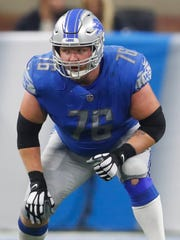 Detroit Lions offensive guard T.J. Lang plays against the New England Patriots.