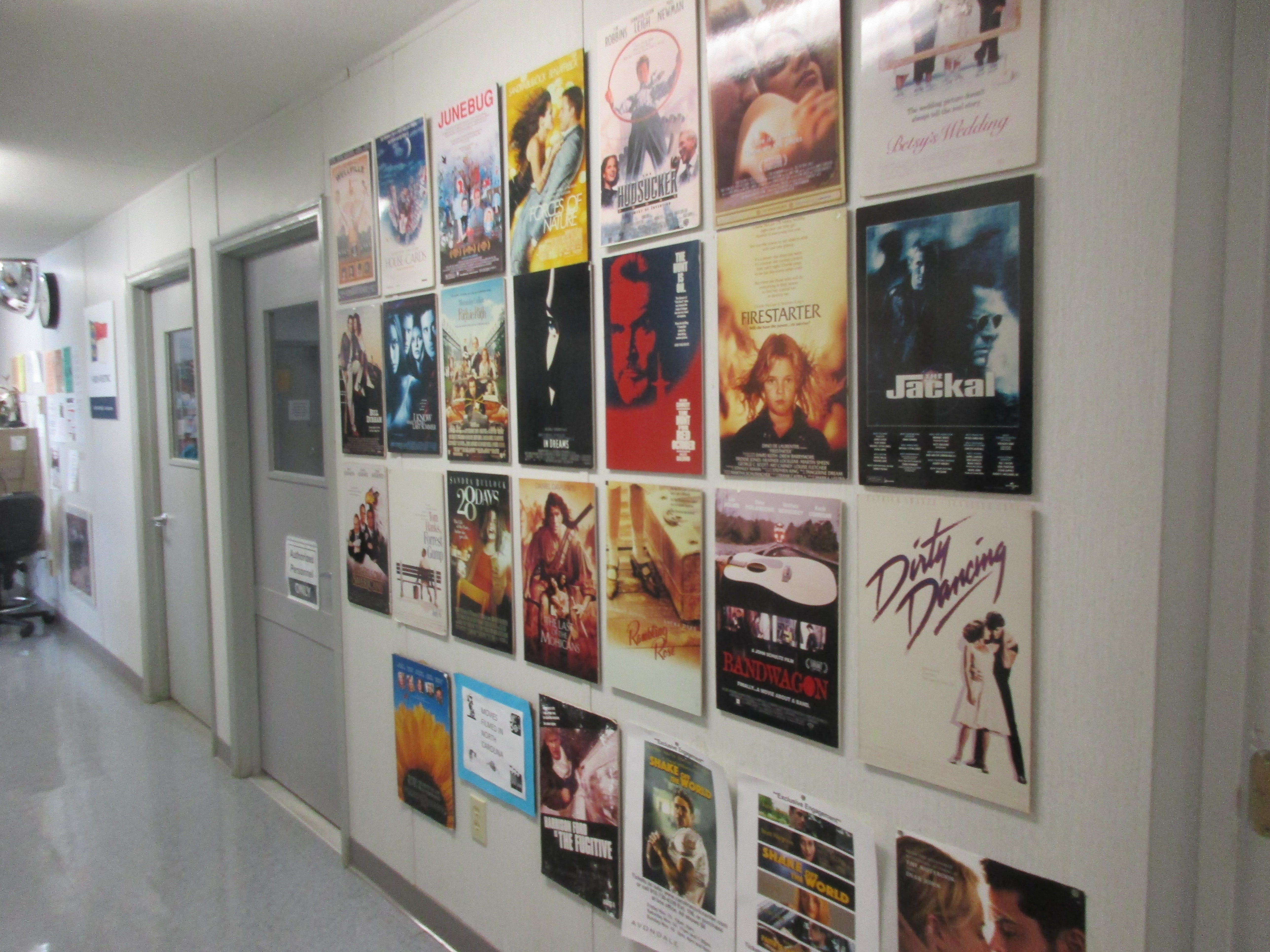 The hall leading to the Visitor Call Center is line with posters advertising the many films made in North Carolina.