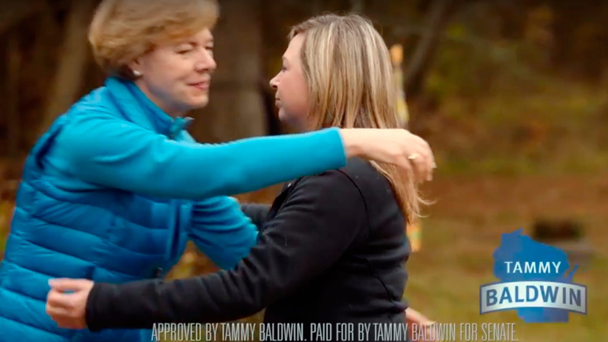 This photo from a television campaign ad provided by the Tammy Baldwin for Senate campaign shows Wisconsin Democratic Sen. Tammy Baldwin, left, embracing Heather Simcakoski, the widow of a Marine veteran who died at the Tomah Veterans Affairs Medical Center. The spot is one two ads released Sept. 27, 2018.
