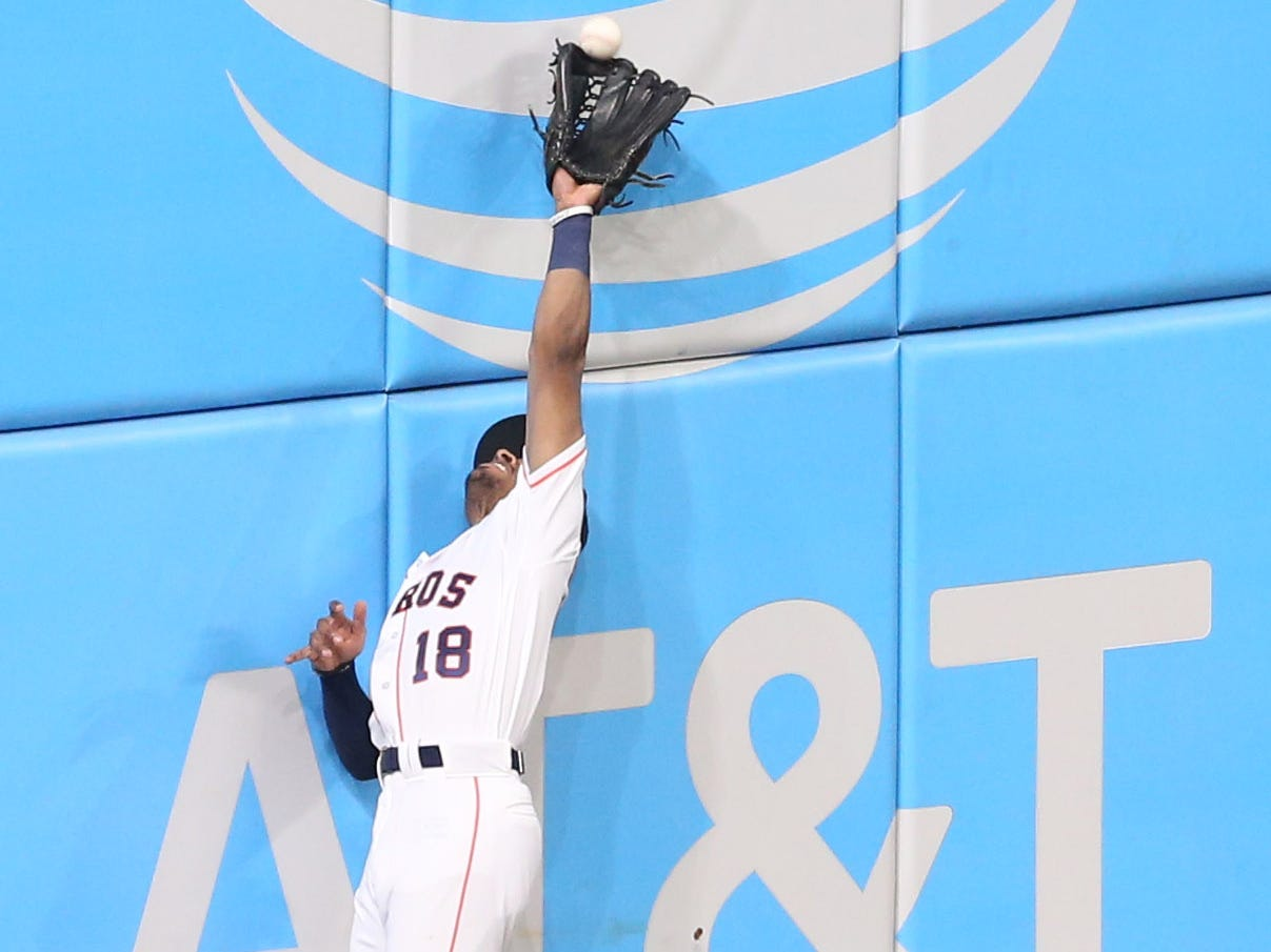 ALCS Game 5: Astros outfielder Tony Kemp can't make the catch at the wall.