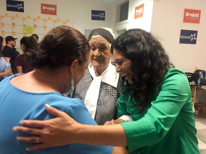 Democratic congressional hopeful Xochitl Torres Small, right, greets supporters at the opening of her Sunland Park, New Mexico, office Oct. 3, 2018.
