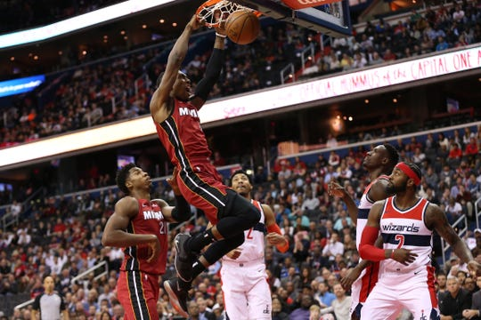 Oct. 18: Miami Heat forward Josh Richardson dunks the ball as Washington Wizards guard John Wall looks on in the first quarter at Capital One Arena.