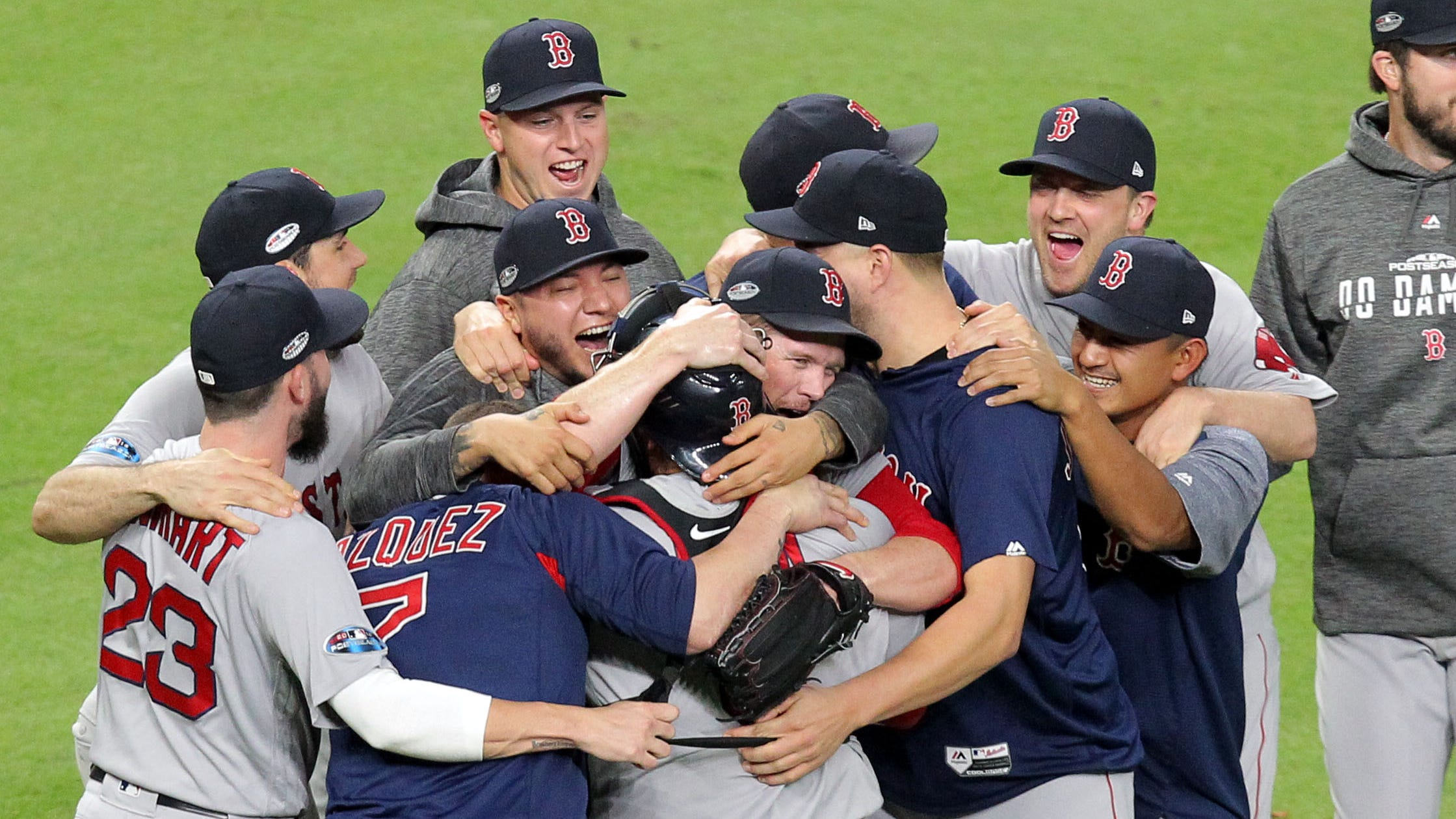 Red Sox players celebrate on the field in Houston after defeating the Astros in the ALCS to advance to the World Series.
