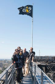Prince Harry, Australia's Prime Minister Scott Morrison, second right, and Invictus Games representatives on the Sydney Harbour Bridge to send up the Invictus Games flag on Oct. 19, 2018.