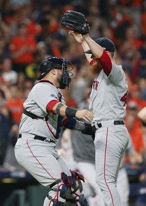 Red Sox closer Craig Kimbrel and catcher Sandy Leon celebrate after winning the ALCS.