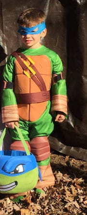 Jude Herron, in a store-bought TMNT costume in 2015, which cost $11.30.