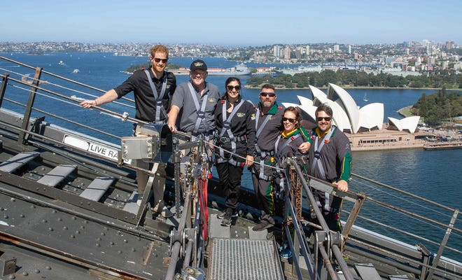 Prince Harry with Australia's Prime Minister Scott Morrison (2/L) and Invictus Games representatives climb the Sydney Harbour Bridge on Oct.19, 2018. Climbing this bridge, with the fantastic view of the Sydney Opera House and the city's harbor stretching below, is a popular to-do item for visitors to Australia, royal and non-royal alike.