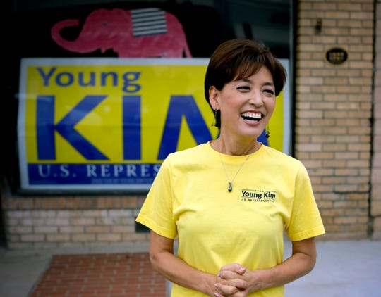 Young Kim, a candidate for a U.S. House seat in the 39th District in California, smiles outside her campaign office in Yorba Linda, Calif., on Oct. 6, 2018.