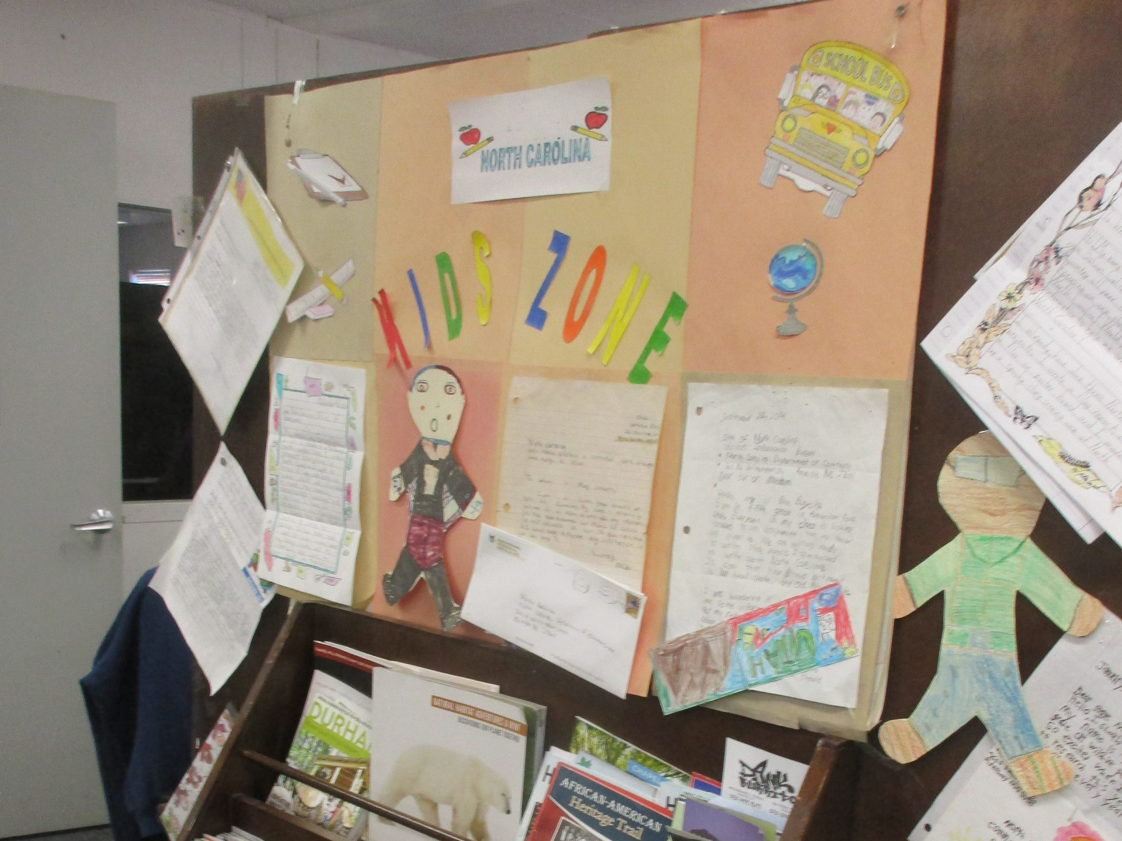 The room also holds racks of tourist brochures; at the end of the computer bank is a display of letters from children in places like Salinas, California, or the grade-schoolers in North Pole, Alaska, seeking mailed information.