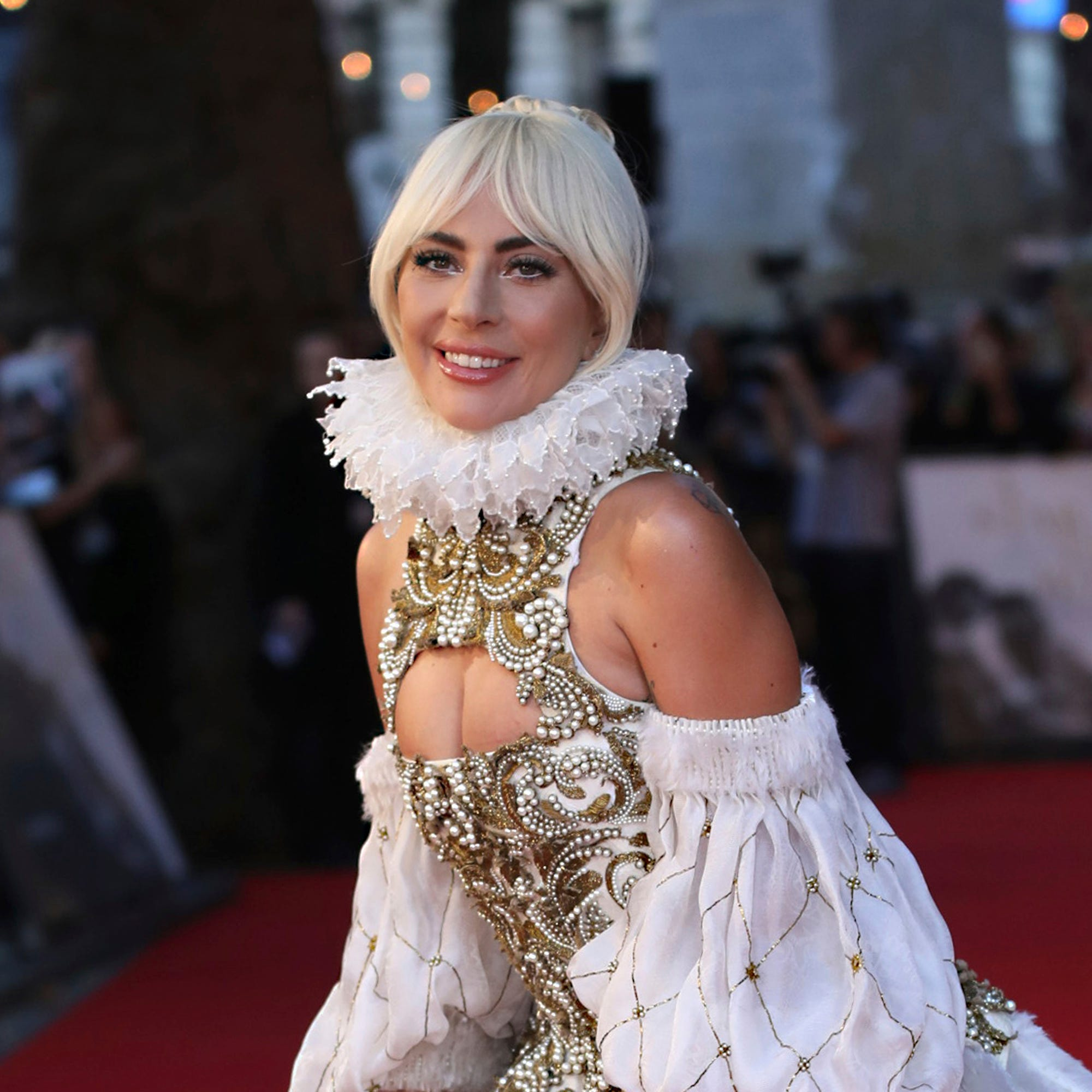 "FILE - In this Sept. 27, 2018, file photo, actress and singer Lady Gaga poses for photographers upon arrival at the premiere of the film ""A Star Is Born"" in London. Next year's Met Gala theme will be 'camp,' organizers revealed Tuesday, Oct. 9. It's a shift in tone and content from this year's meditation on Catholicism. The celebrity co-chairs will include Lady Gaga, Serena Williams and Harry Styles, along with Gucci designer Alessandro Michele and Vogue editor Anna Wintour. (Photo by Vianney Le Caer/Invision/AP, File) ORG XMIT: NYHK206"