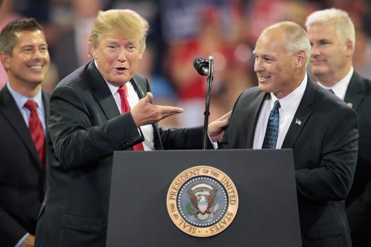 President Donald Trump introduces Pete Stauber, Republican candidate for the U.S. House in Minnesota's 8th District, during a campaign rally on June 20, 2018. in Duluth, Minnesota.