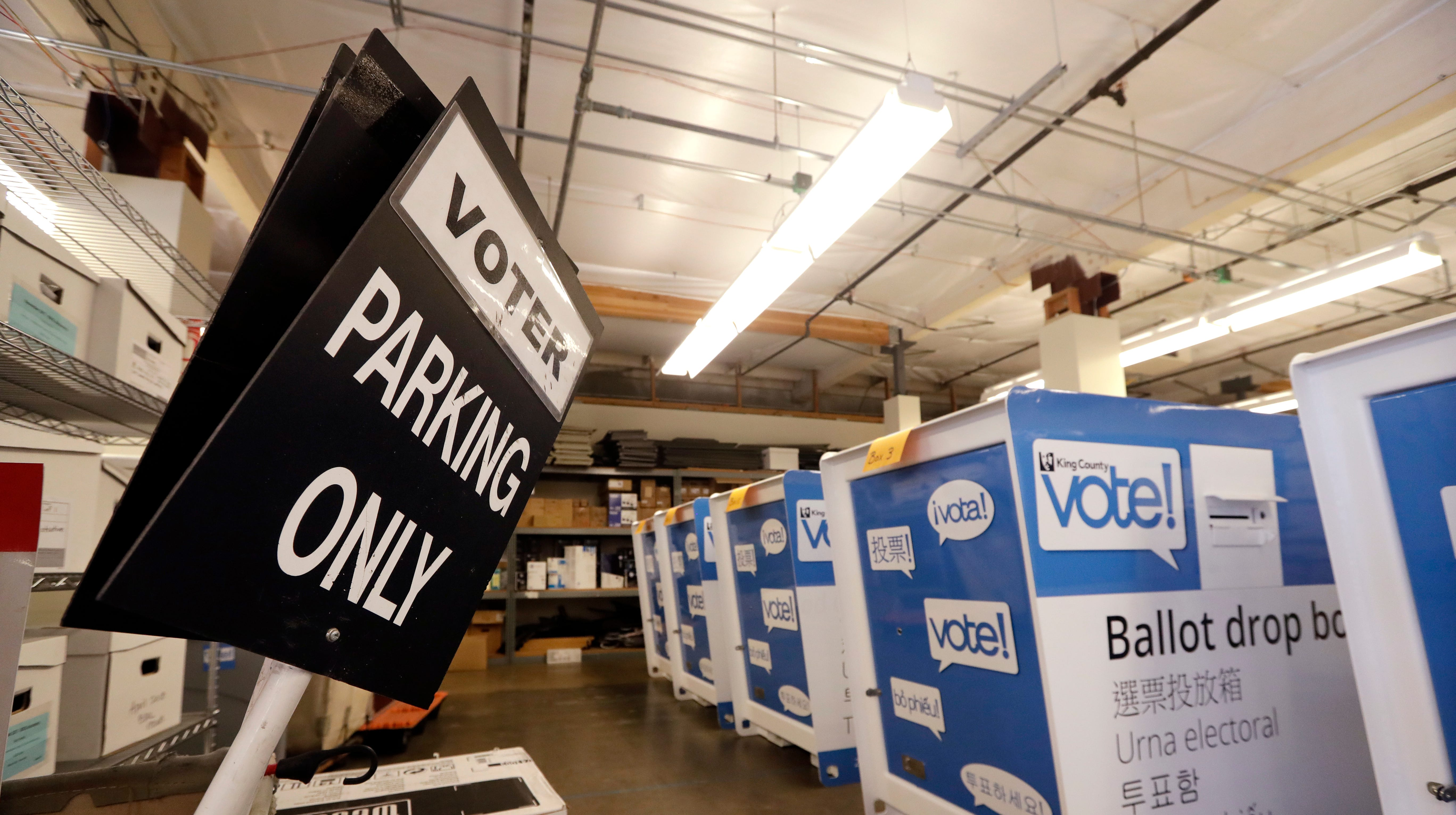 In this photo taken Sept. 19, 2018, ballot drop boxes are stored with other voting equipment in a warehouse portion of the King County Elections office in Renton, Wash.