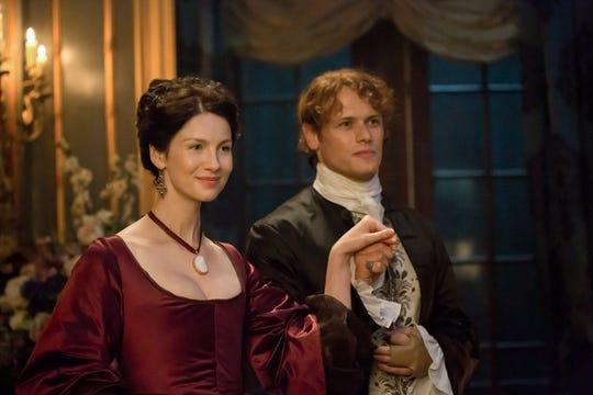 "Claire (Caitriona Balfe) and Jamie (Sam Heughan) take Paris in ""Outlander"" Season 2 on Starz. The series is based on Diana Gabaldon's popular books."