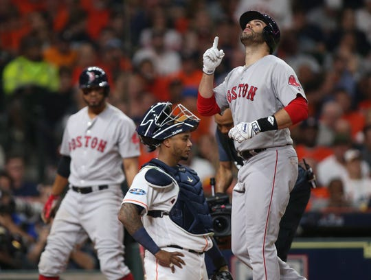 Red Sox outfielder J.D. Martinez reacts after hitting a solo home run in the third inning of Game 5 of the ALCS on Oct. 18.