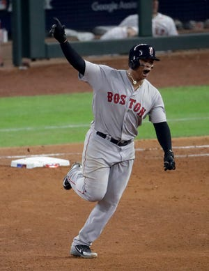 Red Sox's Rafael Devers rounds the bases after a three-run home run in the sixth inning.