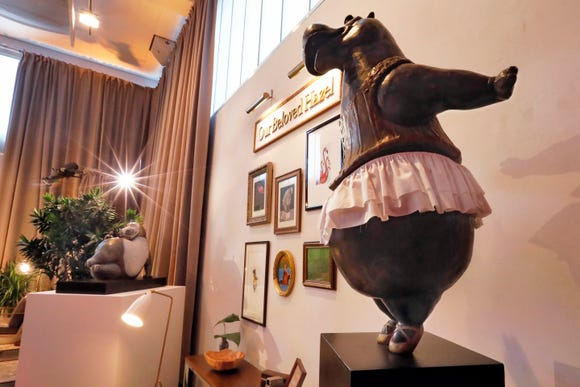 A bronze hippo by Danish sculptor Bjørn Okholm Skaarup appears during a preview of the Neiman Marcus Christmas Book in New York, Thursday, Oct. 18, 2018.