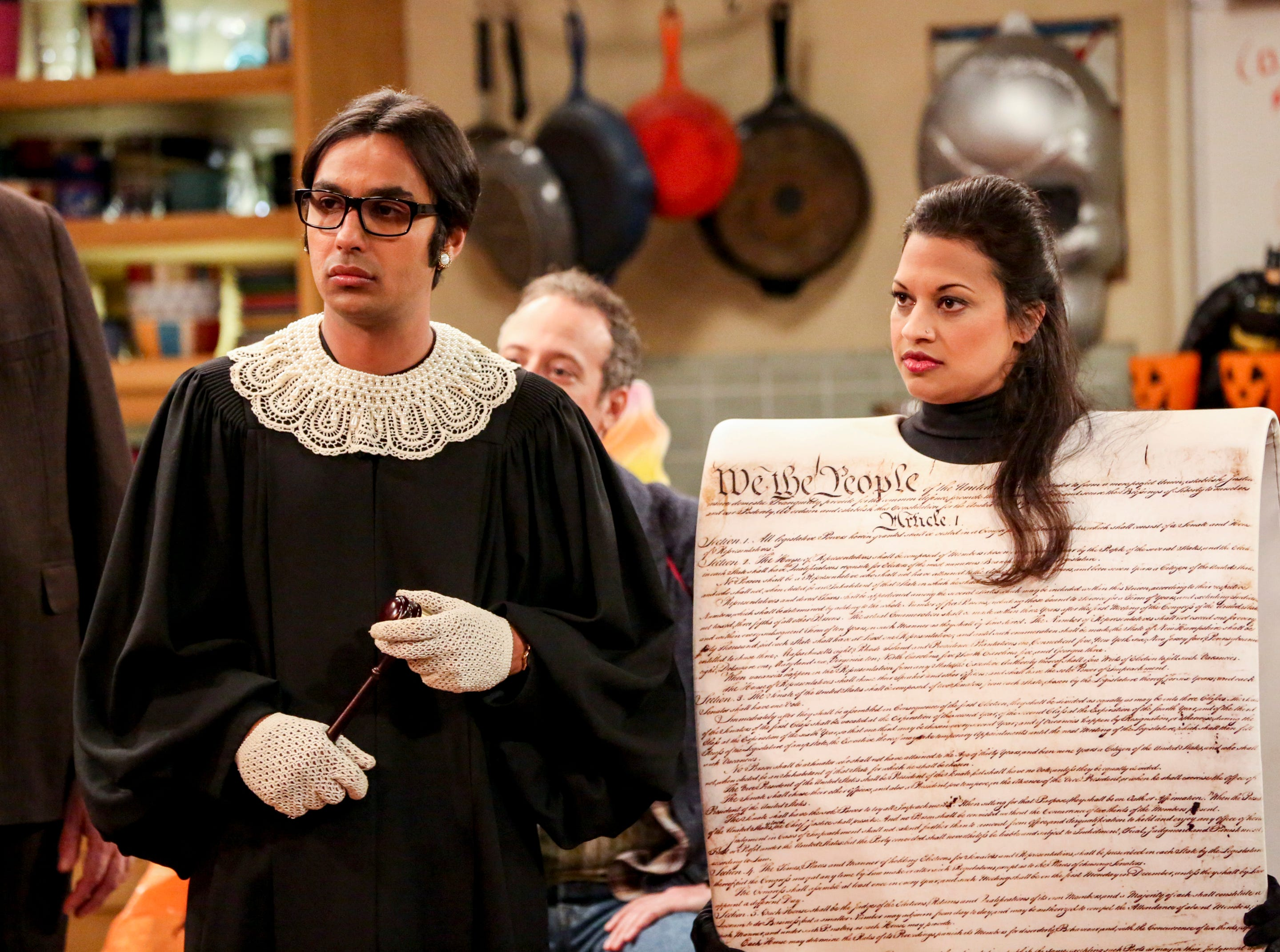Rajesh Koothrappali (Kunal Nayyar) and Anu (Rati Gupta) go political with their costumes as Justice Ruth Bader Ginsberg with a life-size Constitution.
