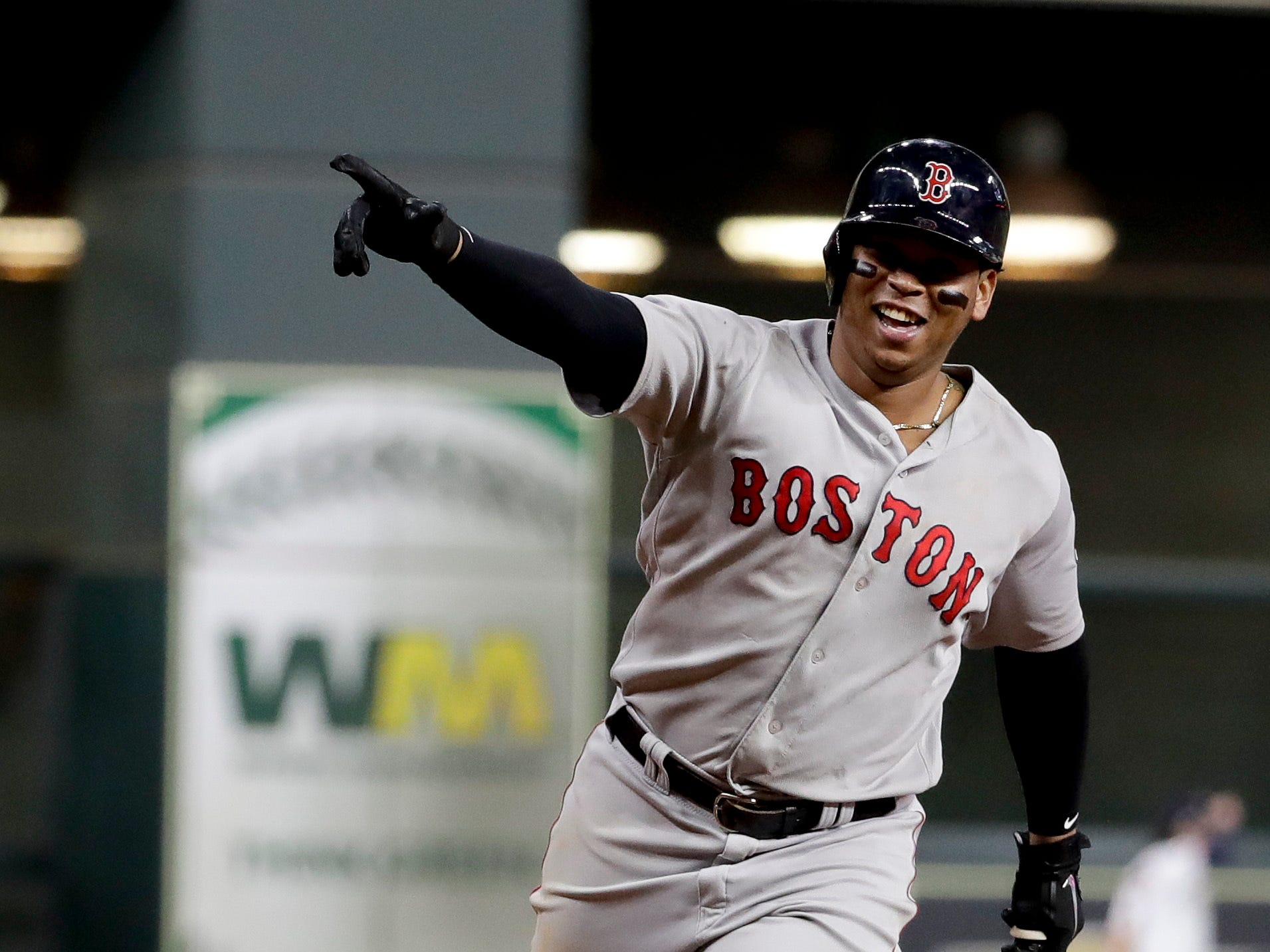 ALCS Game 5: Red Sox's Rafael Devers celebrates his three-run home run against in the sixth inning.