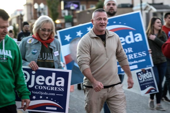 Democrat candidate for West Virginia's Third Congressional District Richard Ojeda marches in the homecoming parade for Marshall University in Huntington, West Virginia, on Oct. 18, 2018.
