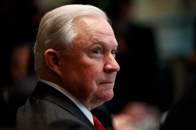 Attorney General Jeff Sessions listens during a cabinet meeting with President Donald Trump in the Cabinet Room of the White House, Wednesday, Oct. 17, 2018, in Washington.