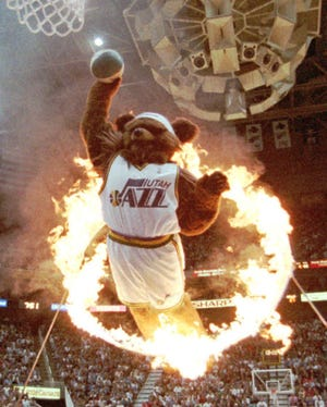 In one of his early appearances, Jon Absey as Jazz Bear leaps through a flaming hoop during a November 1995 game against the Chicago Bulls in Salt Lake City.