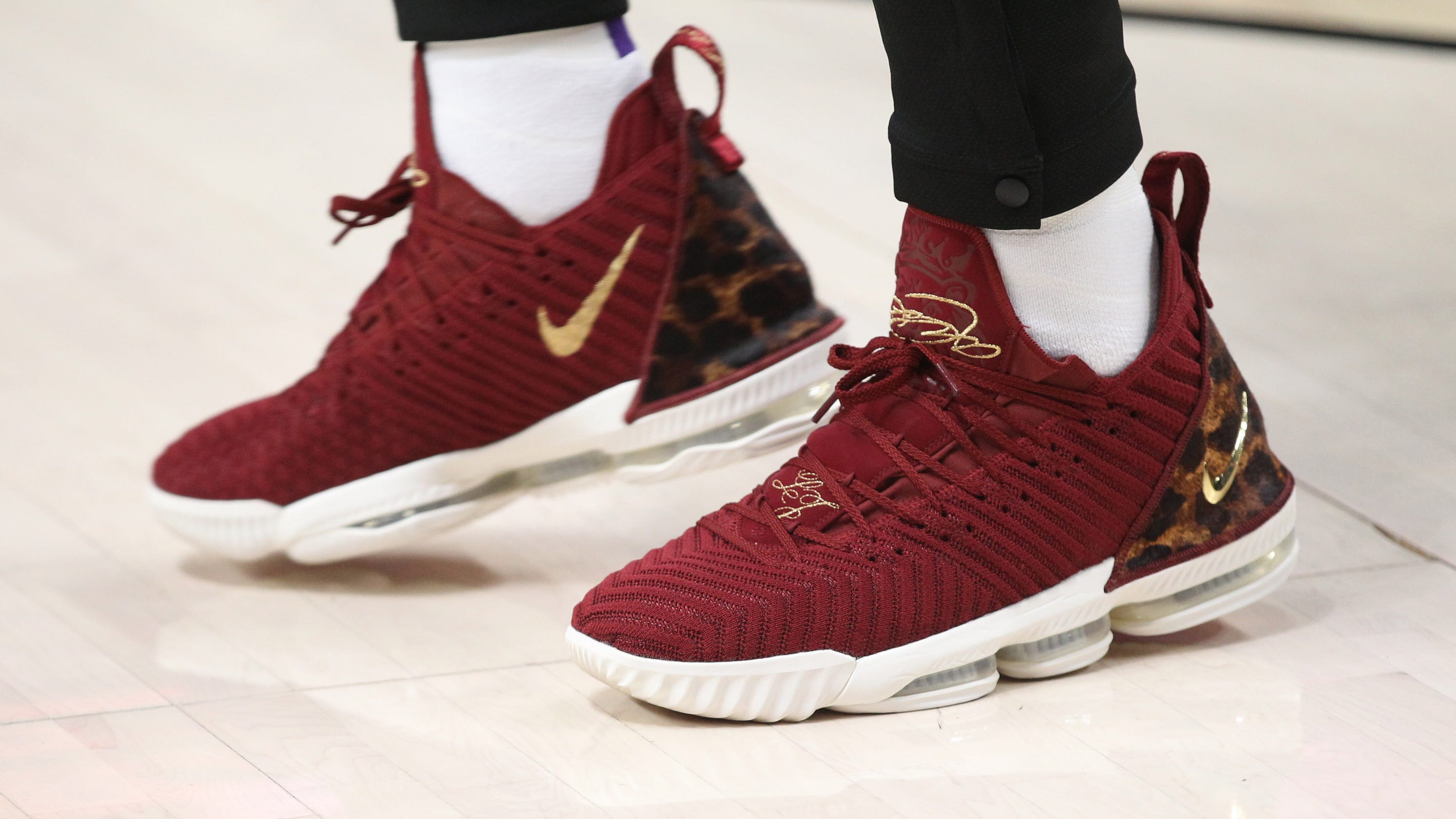 cdecc340a0470 LeBron James  Gold and burgundy shoes not nod to former team