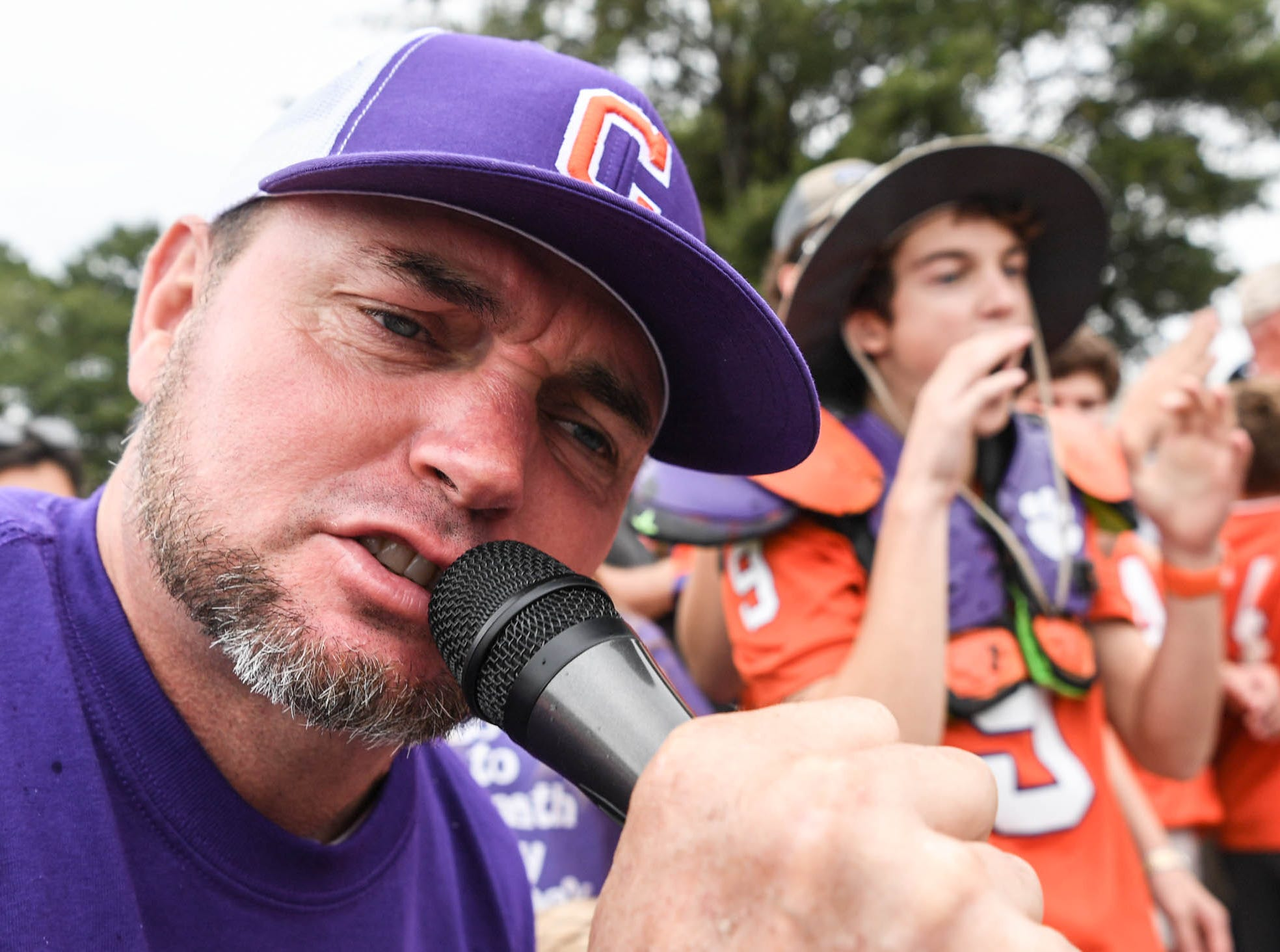 Clemson fan Gary Dyches of Anderson leads a cheer near his son Easton, right, minutes before Tiger Walk before the game in Memorial Stadium on Saturday, October 20, 2018.