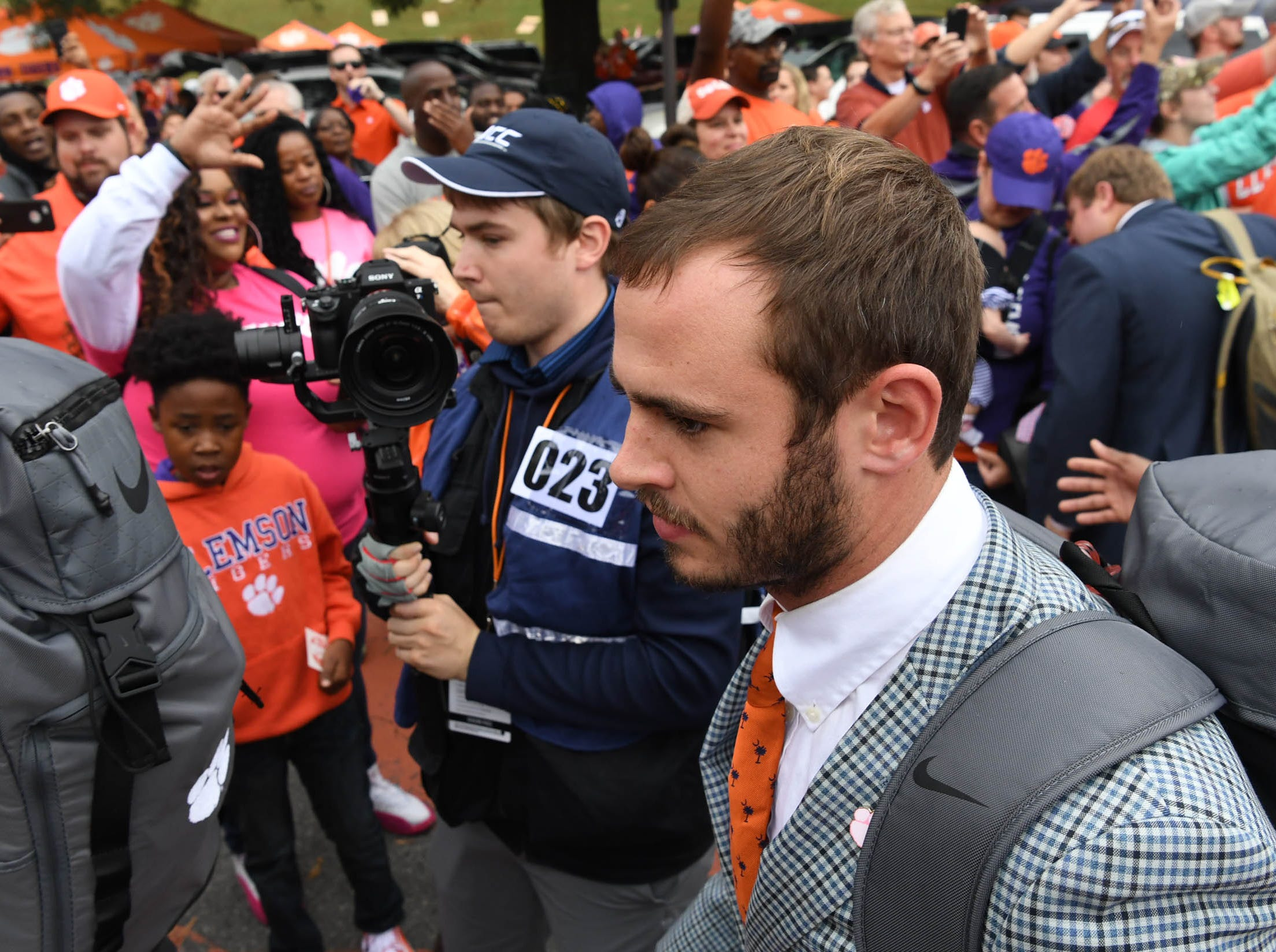 Clemson wide receiver Hunter Renfrow (13) walks by fans during Tiger Walk before the game in Memorial Stadium on Saturday, October 20, 2018.