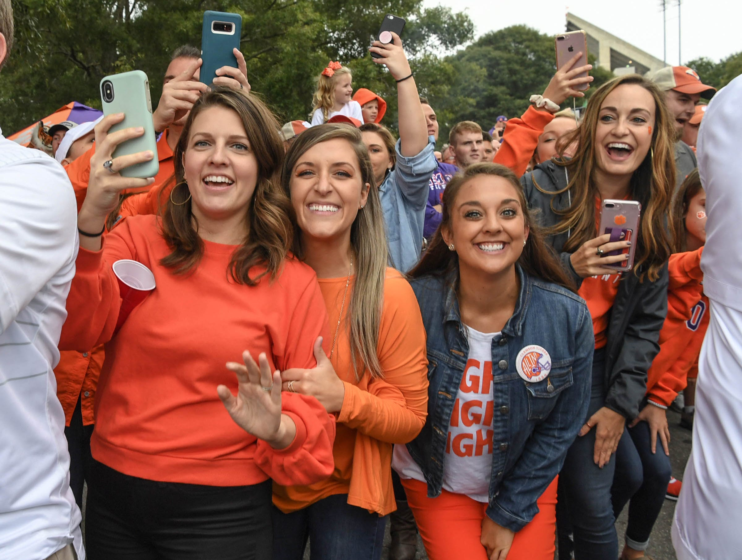 Clemson fans smile during Tiger Walk before the game in Memorial Stadium on Saturday, October 20, 2018.