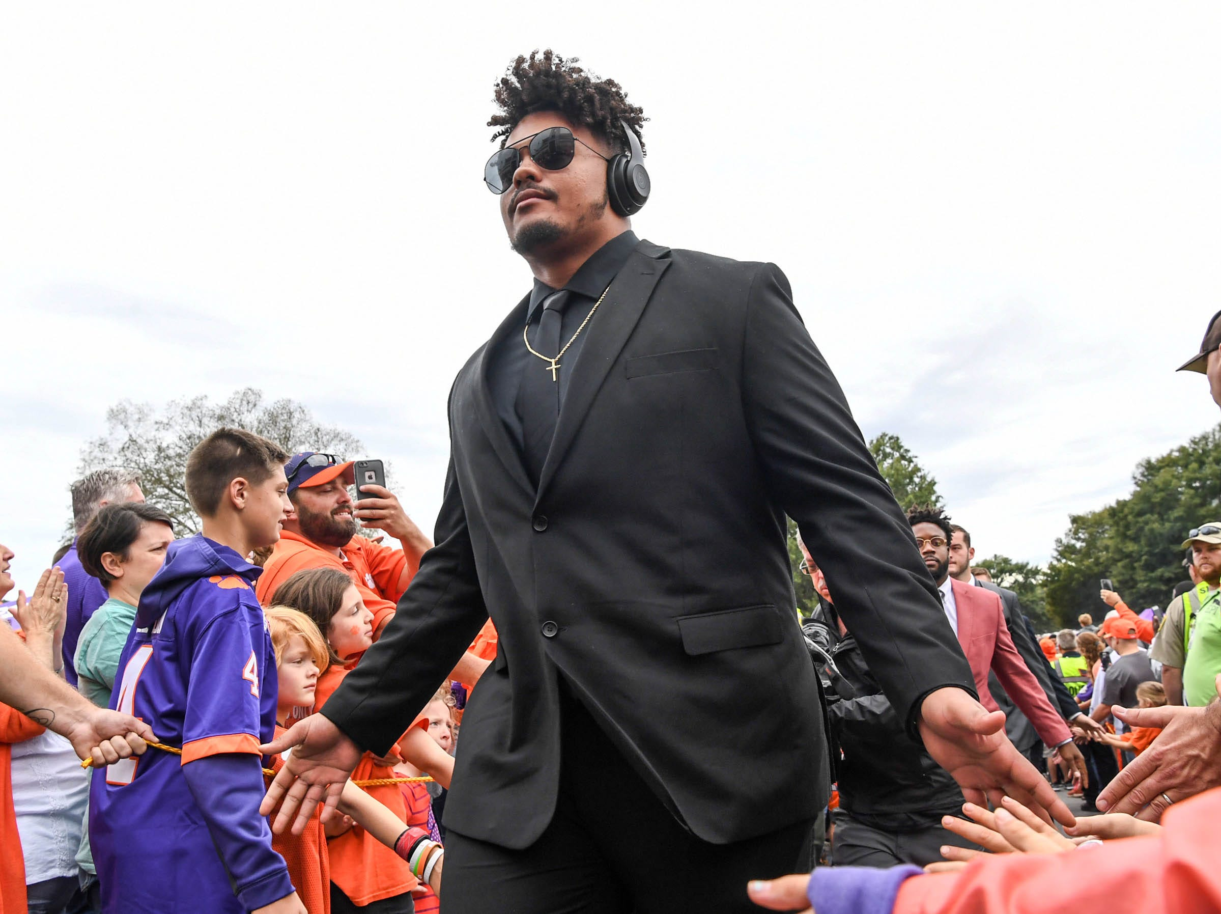 Clemson offensive lineman Jackson Carman (79) walks by fans during Tiger Walk before the game in Memorial Stadium on Saturday, October 20, 2018.