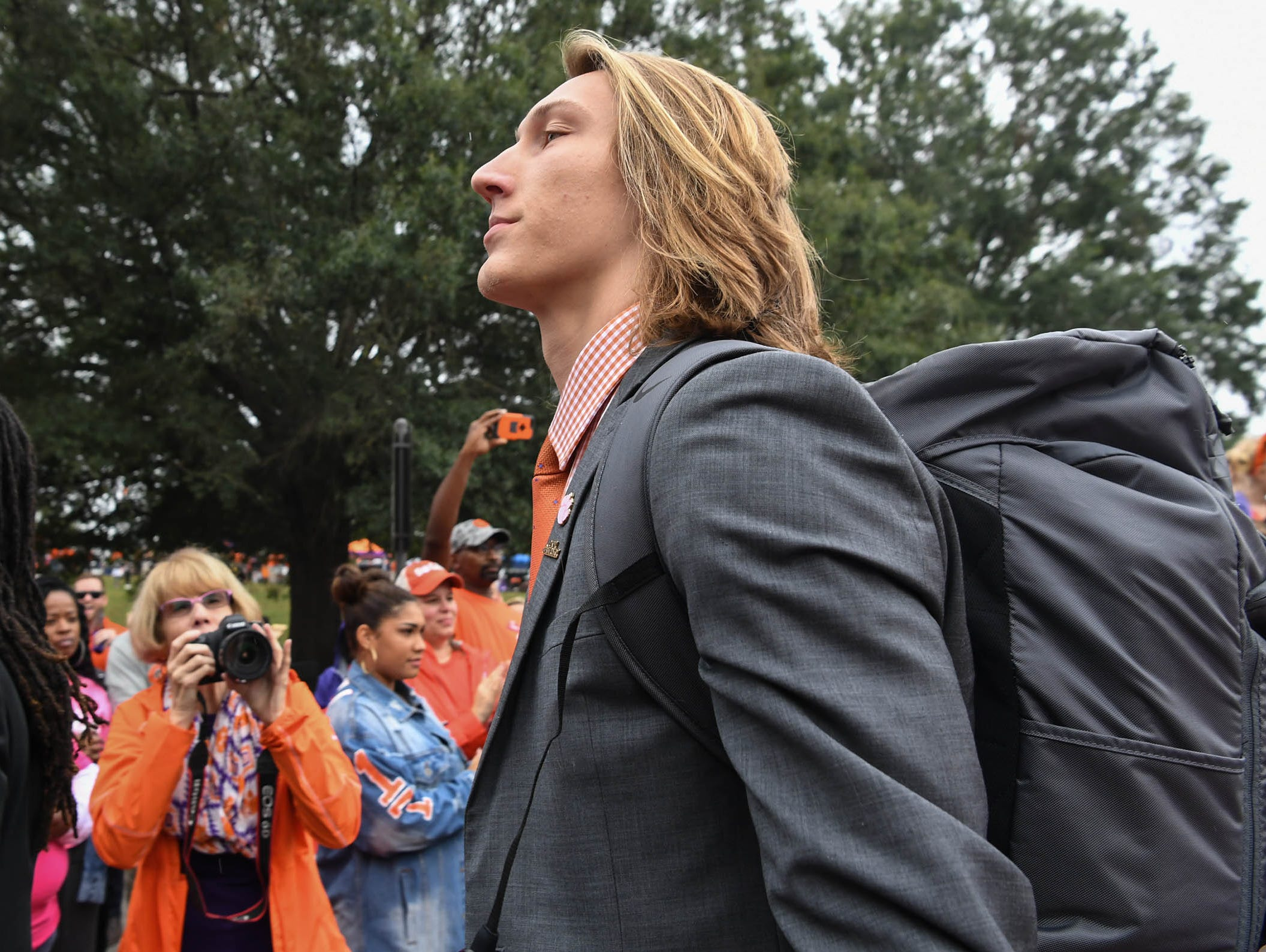Clemson quarterback Trevor Lawrence walks by fans during Tiger Walk before the game in Memorial Stadium on Saturday, October 20, 2018.